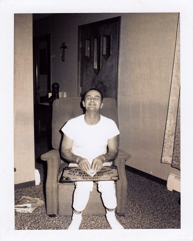 1960s man with ouija board, closed eyes